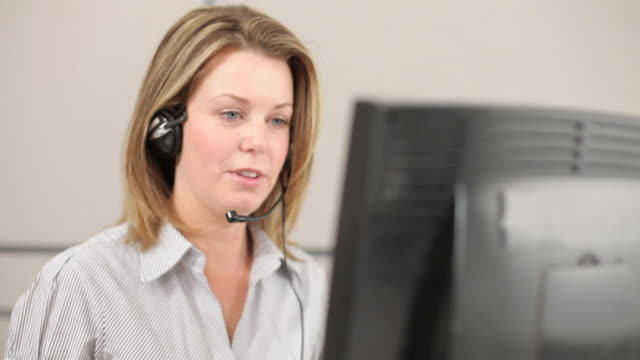 Caucasian Businesswoman talking with headset video