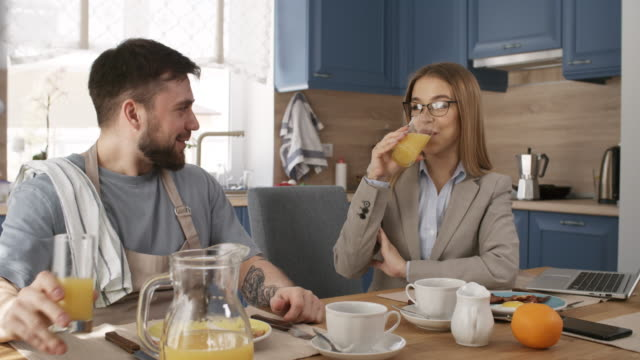 caucasian businesswoman talking with stay-at-home husband at breakfast - stay at home parent stock videos & royalty-free footage