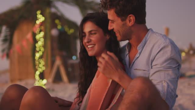 Caucasian couple cuddling on the beach