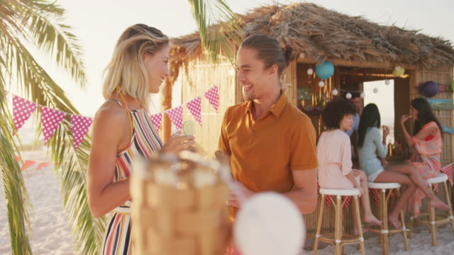 Caucasian couple enjoying a party at beach