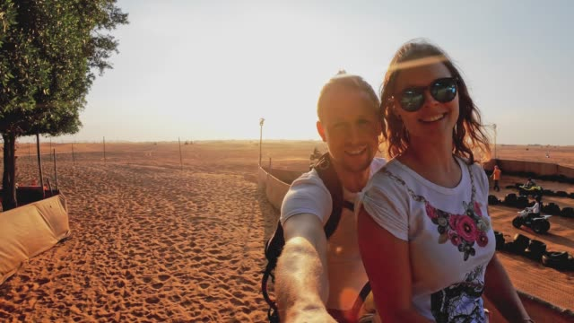 POV - Caucasian couple riding a camel in Dubai desert video