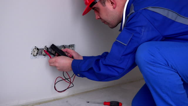 Caucasian electrician working on wall socket video