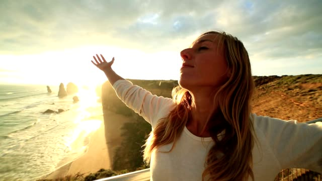 Caucasian female arms outstretched at sunset video