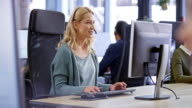 istock LD Caucasian female call center agent providing customer support sitting at her workstation 1163714142
