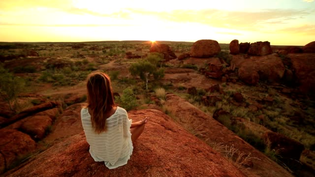 Caucasian female meditating at sunrise video