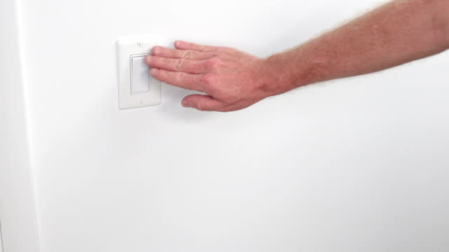 Caucasian Hand Turning On and Off Light Switch video