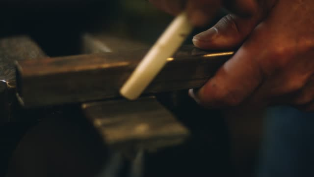 A Man Marks on Metal
