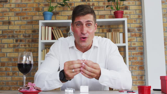 Caucasian man making video call presenting ring and making marriage proposal