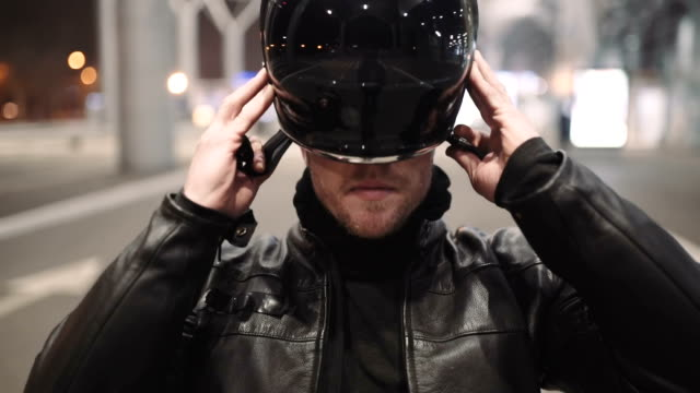 caucasian man motorcyclist wears a helmet on night street caucasian man motorcyclist wears a helmet on night motorcycle stock videos & royalty-free footage