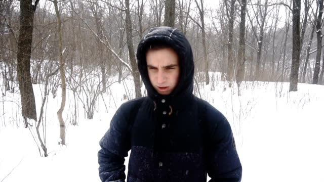 caucasian man smelling stinky crinkle face on white snow background - yeti video stock e b–roll