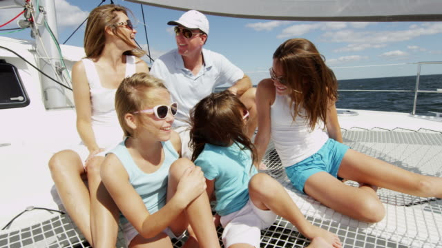 caucasian parents and daughters vacation sailing family yacht - soldato semplice video stock e b–roll