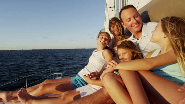 caucasian parents and daughters vacation sailing family yacht - financial planning stock videos & royalty-free footage