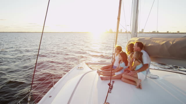 Caucasian parents and daughters vacation sailing family yacht Three young sisters Caucasian parents holiday family investment group tourism advertisement luxury sailing yacht ambition RED EPIC mast sailing stock videos & royalty-free footage