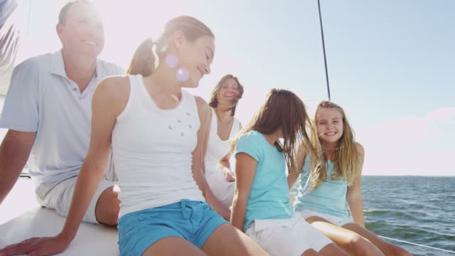 caucasian parents and three daughters on luxury catamaran - financial planning stock videos & royalty-free footage