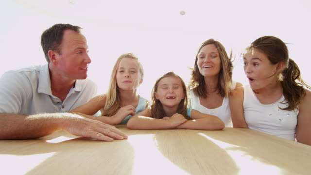 caucasian parents daughters using skype uplink on yacht - financial planning stock videos & royalty-free footage