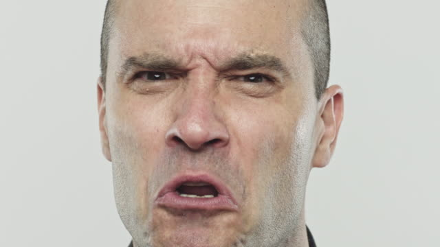 Caucasian real man talking angry to camera