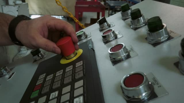 A Caucasian Technician in His Thirties Presses Buttons and Controls in an Indoor Manufacturing Facility A Caucasian Technician in His Thirties Presses Buttons and Controls in an Indoor Manufacturing Facility push button stock videos & royalty-free footage