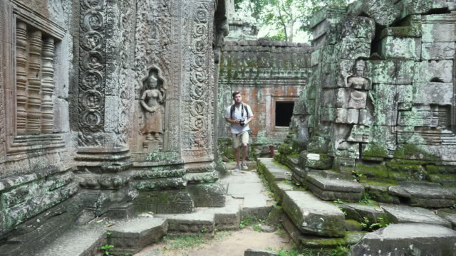Caucasian Tourist Wandering through Cambodian Ruins video