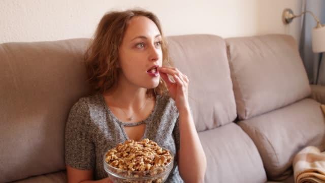 caucasian woman eating walnuts - славянская культура стоковые видео и кадры b-roll