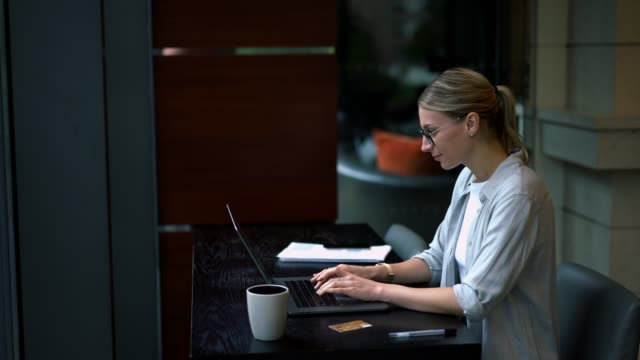 Caucasian woman typing text request on laptop computer for searching information on website using internet connection