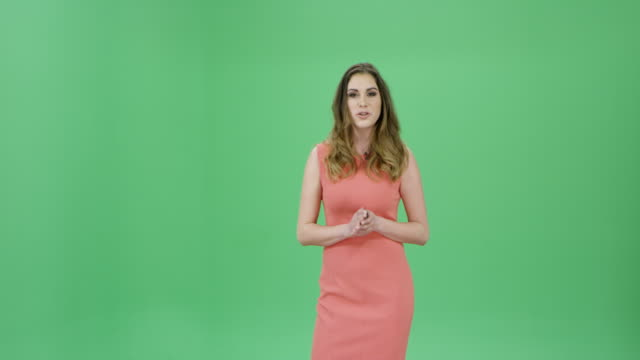 Caucasian woman with long brown hair presenting the weather forecast video