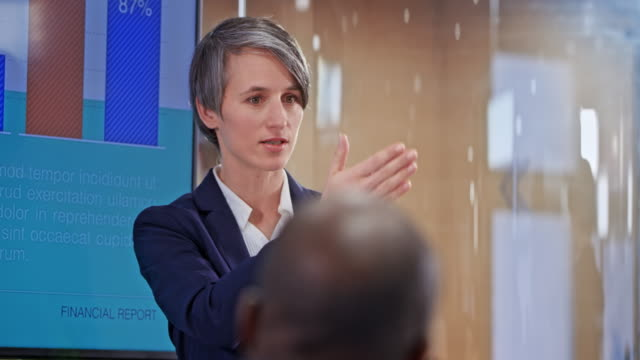 Caucasian woman with short haircut holding a presentation in the conference room