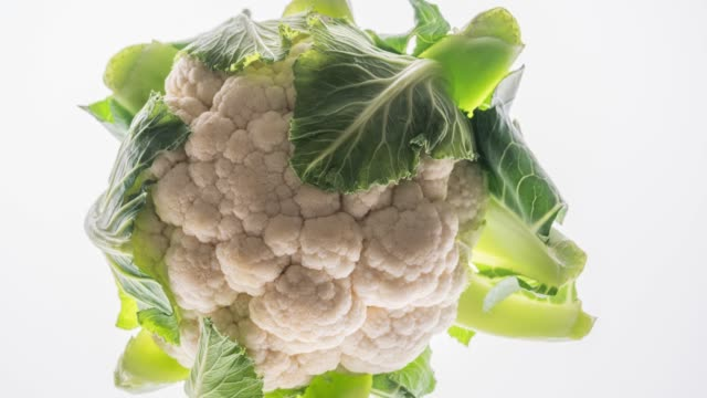 Cauliflower isolated on white Cauliflower isolated on white. cabbage stock videos & royalty-free footage
