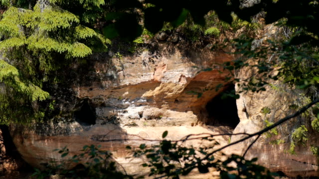 Caustic light reflections on sandstone cliffs Caustic light reflections on sandstone cliffs with caves caustic light effect stock videos & royalty-free footage