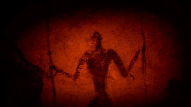 Cave Art Human Figures In Fire Light Moving across ancient cave paintings of hunters illuminated by firelight cave stock videos & royalty-free footage