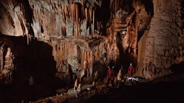 PAN Cavers exploring a large cave