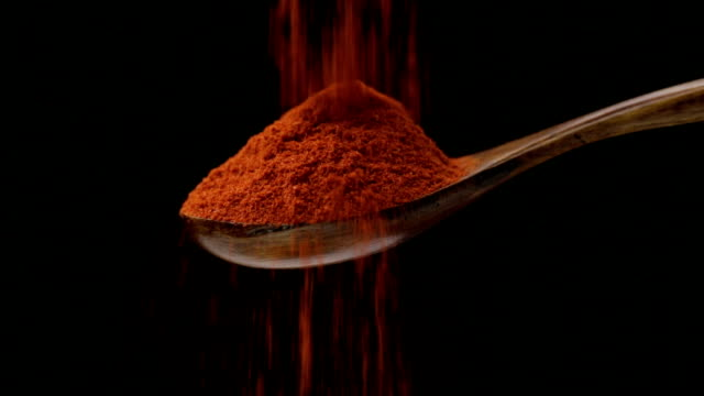 Cayenne pepper Cayenne pepper is falling into a wooden spoon spice stock videos & royalty-free footage