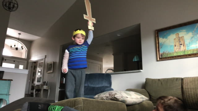 CC-Kraft-Family1-StillsVideo King Two young brothers practice their swordplay and see who is king of the couch cushions. knight person stock videos & royalty-free footage