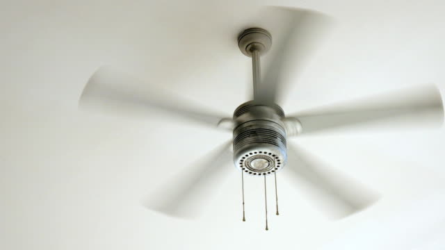 ceiling fan rotating - ritemprarsi video stock e b–roll