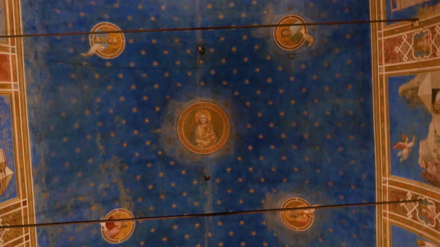 Ceiling of the Scrovegni Chapel frescoed by Giotto, Padua Padua 2019. Ceiling of the Scrovegni Chapel, frescoed by Giotto. The chapel has recently been modernized with a new LED lighting system. December 2019 in Padua renaissance architecture stock videos & royalty-free footage