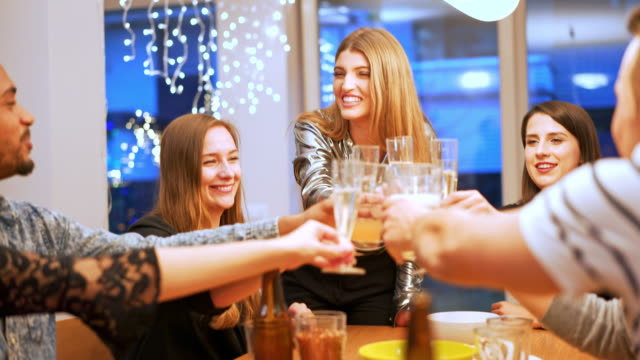Celebrating New Year's eve and toasting with champagne Friends celebrating New Year's at home. They are toasting with champagne. new year's eve stock videos & royalty-free footage