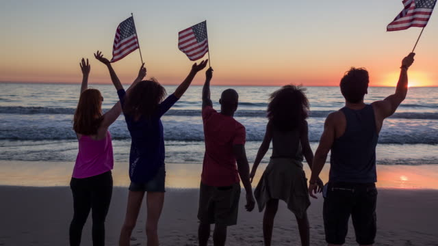 celebrating on the beach - july 4th stock videos & royalty-free footage