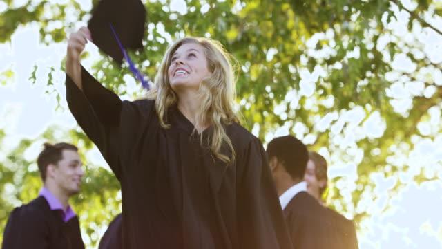 celebrating success - graduation cap stock videos & royalty-free footage