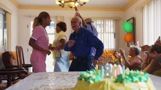 Celebration Of Birthday Party With Happy Elderly People In Clinic video