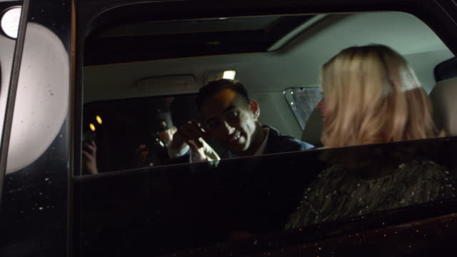 Celebrity couple arriving in limo, photographed by paparazzi, shot on R3D video