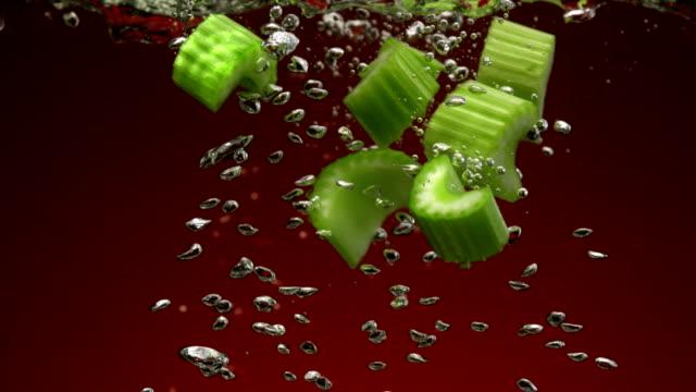 Celery in water, Slow Motion Celery in water shooting with high speed camera, phantom flex. celery stock videos & royalty-free footage