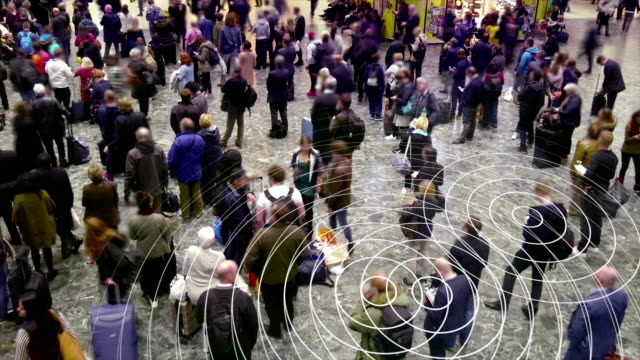 Cell phone radio signals in a crowd of people. video