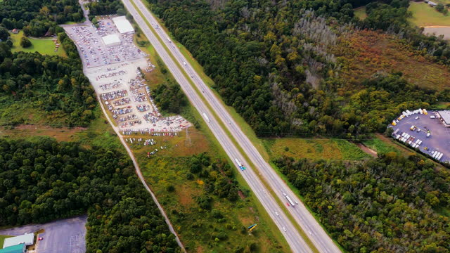 Cell Towers Alongside Interstate and Large Car Auction Facility video