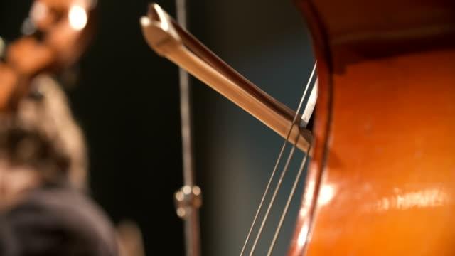 Cello in orchestra. Musician playing Cello video