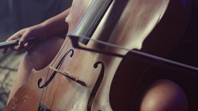 Cello player cellist playing violoncello. Classical musical instrument video
