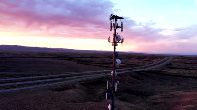 5G Cellular Tower in the Vast and Arid Desolate Desert in Eastern Utah Near Moab at Dusk under a Dramatic Cloudscape