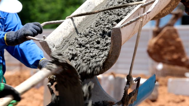 Cement truck is pouring cement on building site Cement truck is pouring cement on building site construction machinery stock videos & royalty-free footage
