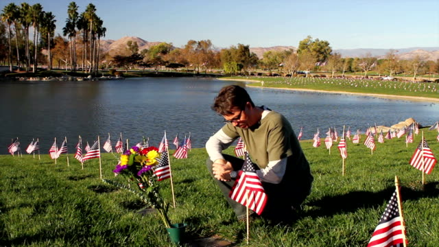 Cemetery Man Visits Grave on Veterans Day Shot at Riverside National Cemetery in California on 11-11-12. memorial day stock videos & royalty-free footage