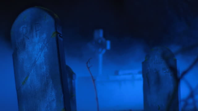 HD: Cemetery Tombstones Shrouded In Fog