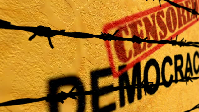 censored demicracy text against barbwire - censura video stock e b–roll