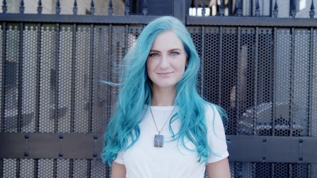 Center Aligned Slow Motion Shot of a Beautiful Unique Spunky Fashionable Young Woman with Fun Cute Teal Blue Green Dyed Hair Standing Posing Outdoors in the Summer Beautiful Unique Spunky Fashionable Young Woman with Fun Cute Teal Blue Green Dyed Hair Standing Posing Outdoors in the Summer blue hair stock videos & royalty-free footage